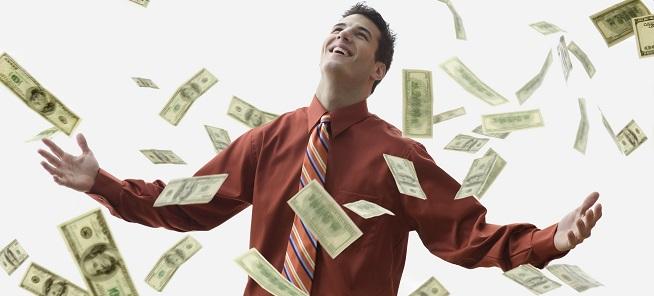 corbis - eleonora - Money Falling on Happy Businessman